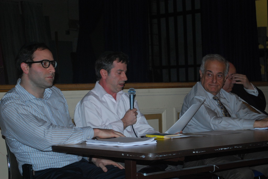 The Lawrence Board of Education voted to sell the Number Six School for $12.5 million. Trustee Uri Kaufman, center, opposed the agreement. Trustee Abel Feldhamer, left, agreed with Kaufman, while Trustee Dr. David Sussman approved of the sale.