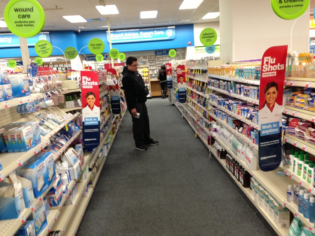 Customers seek relief with over-the-counter remedies to lessen flu symptoms.