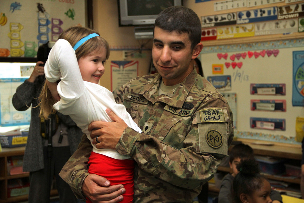 SPC. Michael zervos returned from a tour of duty in Afghanistan and surprised his 5-year-old daughter, Danielle, in her kindergarten class at the Robert W. Carbonaro School on Jan. 9.