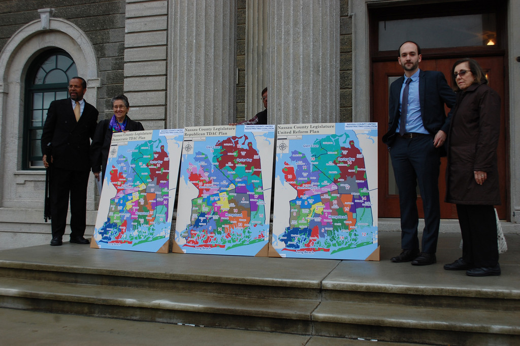 Members of the Nassau County United Redistricting Coalition presented their plan to redraw the 19 legislative districts (map at right), which differs from the maps proposed by the Republicans (center) and Democrats (left).