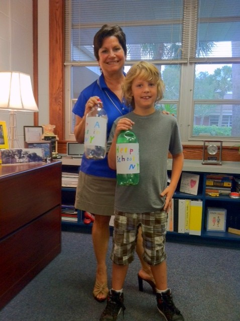 Skylar and his principal Marilou Andrews