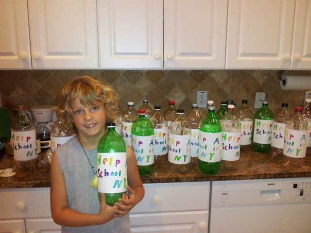 Skylar Mitchell, of Naples, Fla., attached homemade labels to two-liter bottles that he used to collect money to donate to the East Rockaway Education Foundation for Hurricane Sandy relief. His mother, Karen Mitchell, is a 1985 graduate of East Rockaway High School.