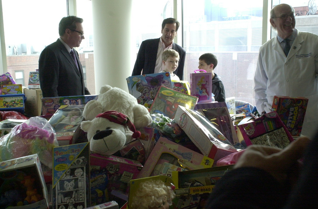 State Sen. Charles Fuschillo Jr., center, checked out the pile of donated toys at the Winthrop-University Hospital Pediatric Department in Mineola with children who are in treatment there.