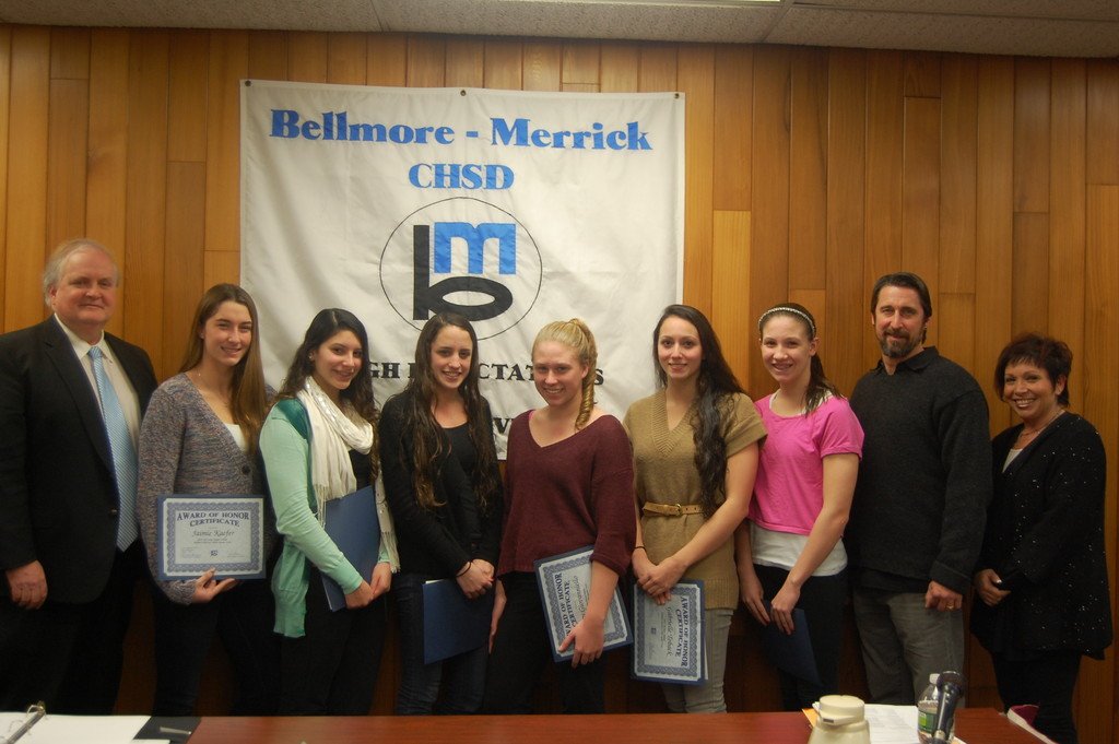 Six members of the Bellmore-Merrick Central High School District girls' swim team, from left, Jaimie Kaefer, Jessica Arana, Paige Kaplan, Kerry Giovanniello, Gabrielle Toback and Elizabeth Walsh, were honored at a January Board of Education for their outstanding performances at the county and state championship meets. They were joined by Superintendent Dr. Henry Kiernan, at left, their coach, Robert Kaefer, and Board of Education President Marion Blane.