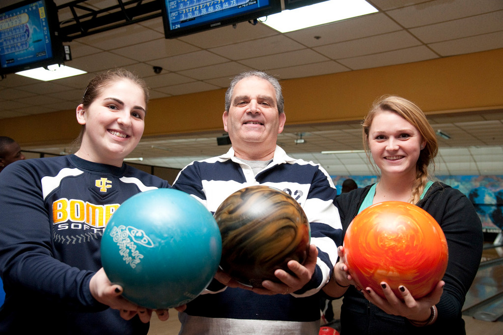 Sydney Folk, left, Long Beach High School teacher Carmine Verde and Haley Birnbaum picked their perfect balls.