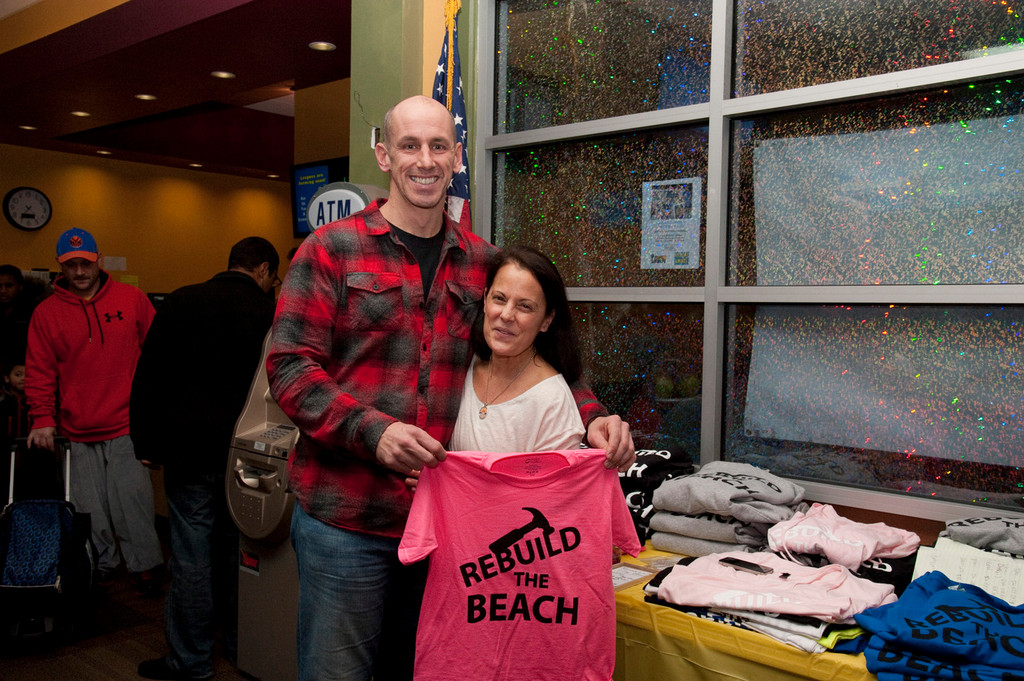Larry Moriarity and Michelle Cazzetto sold T-shirts. Cazzetto was able to donate thousands of dollars in proceeds.