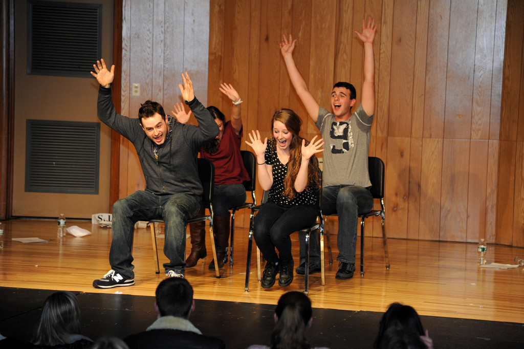 Graduates of W.T. Clarke High School, from left, Gino Gentilini-Pagonis, Toby Klein, Alex Fanelli and Wesley Halstead, recently returned to the school for an improvisational comedy show.
