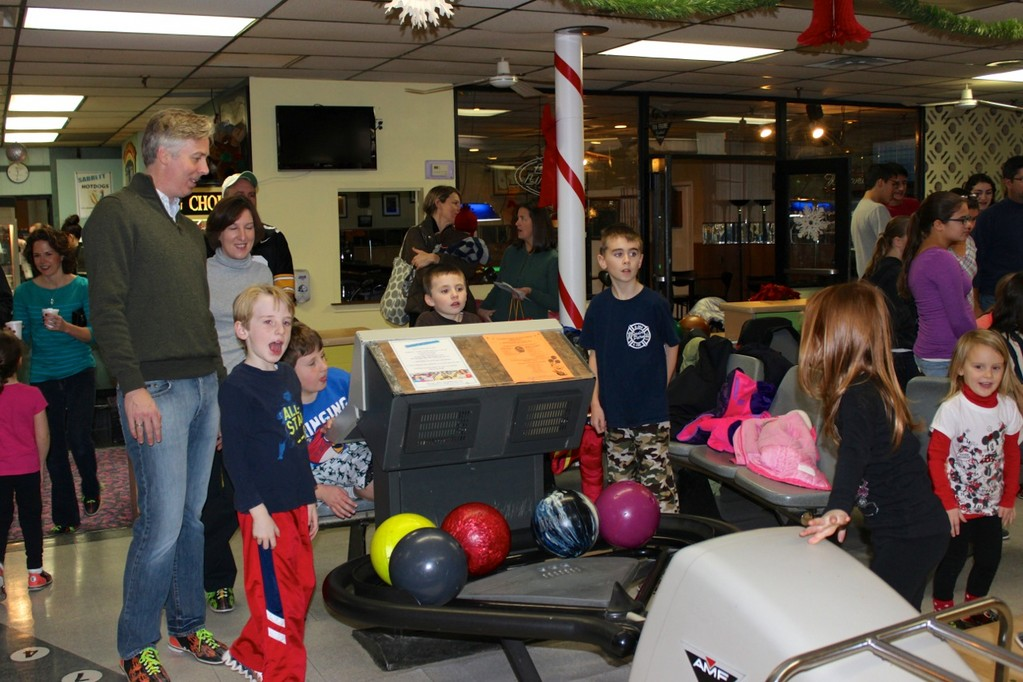 "Bowlers and their families came out to support ""Strikes For Sandy."""