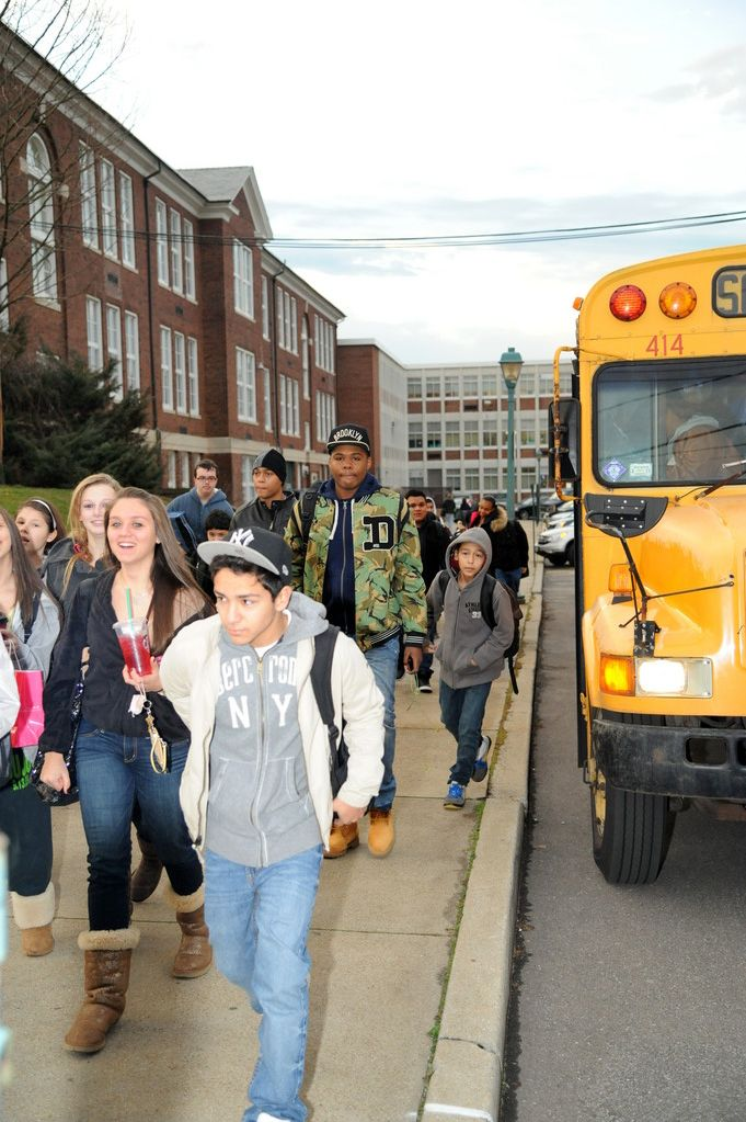 Lawrence High School students relocated to the middle school got off the bus and headed into school this morning.