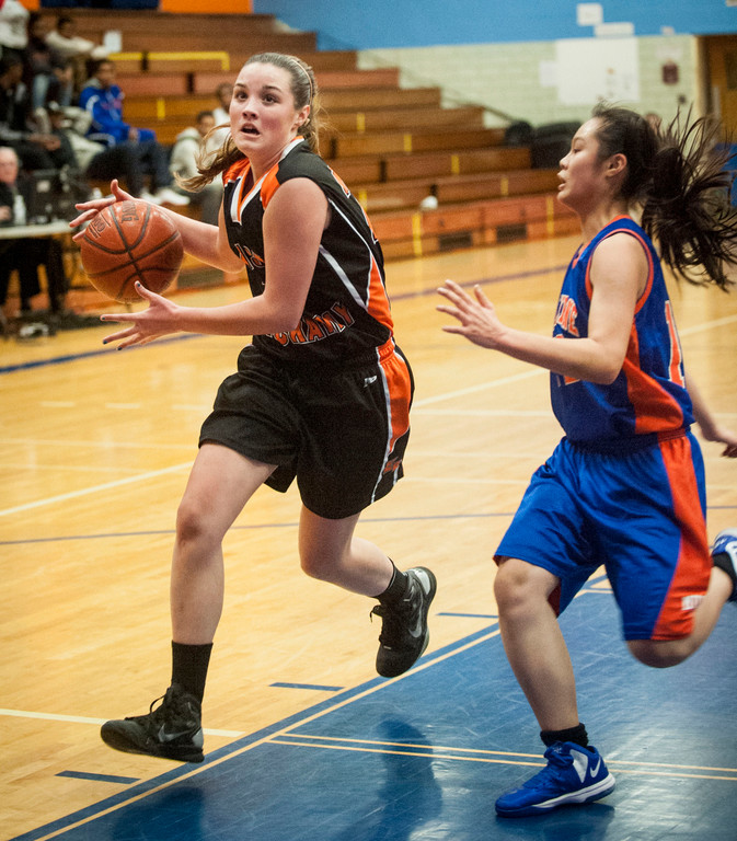 East Rockaway's Kim McCann, left, had nine points and 15 rebounds in the team's 37-31 Conference B-C victory at Malverne.