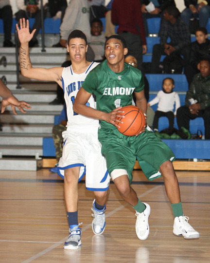 Elmont's Tim Lewis, right, scored a team-high 21 points in last Friday's comeback victory over Conference AA-III rival Long Beach.