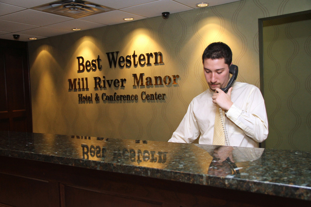 Front Desk Agent Nicholas Horns fields customer calls.