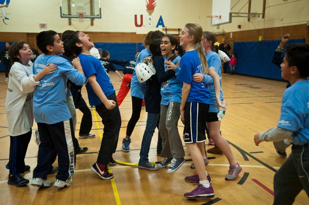 Students from the Brooklyn Avenue School celebrated after they won the District 24 floor hockey tournament on Jan. 15.