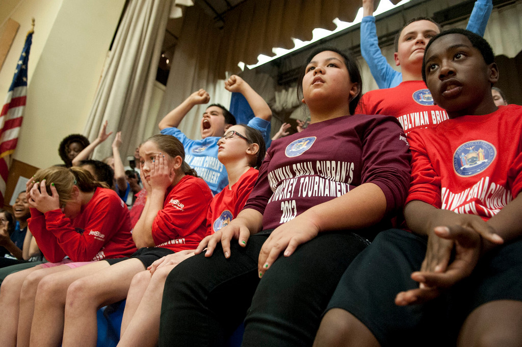 District 24 students reacted either with cheers or sighs as teams from their respective schools faced off.