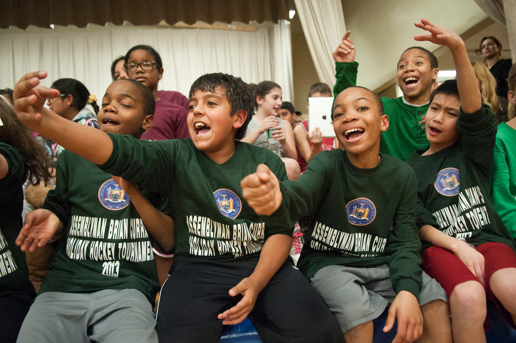 Students from the William L. Buck School cheer on their classmates.