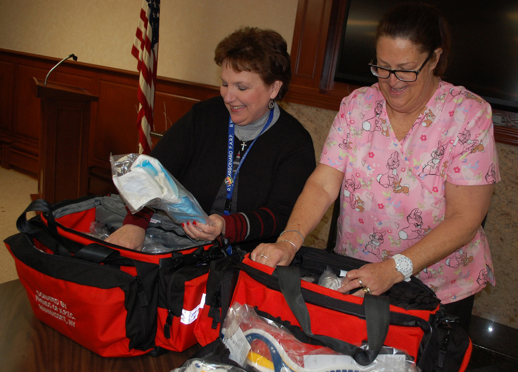 School nurses Estelle Dempsey and Cathy Hicks looked at all the items provided in the kits.