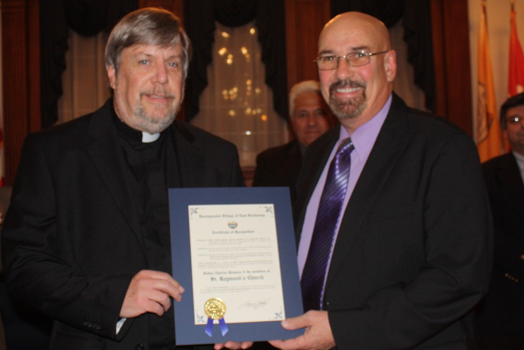 Local spiritual leaders were awarded with citations. Pictured were Father Charles Romano of St. Raymond's Church and Mayor Francis T. Lenahan
