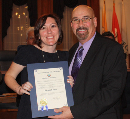 Elizabeth Daitz accepted her certificate from Mayor Francis T. Lenahan.