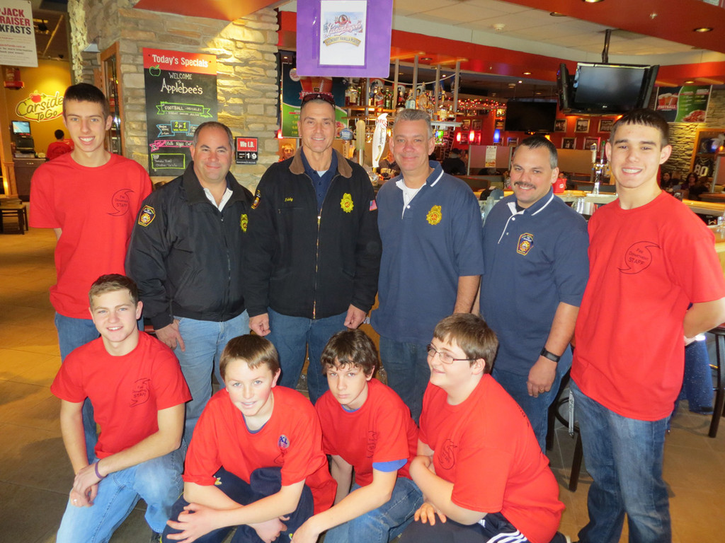 Pictured were the East Rockaway's Fire chiefs Steve Torborg, Ed Reicherter, Jim were members of the Lynbrook and RVC juniors, wearing T-shirts made especially for the event.