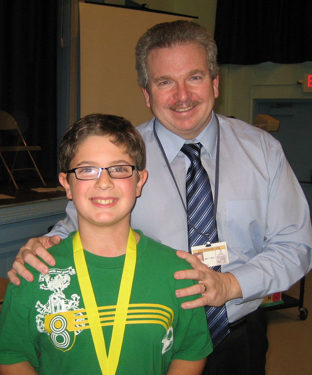 "Centre Avenue Elementary school fifth-grader Joseph Acampora won the school-level Nat Geo ""Bee"" on January 11. He is pictured here with his principal, Tim Silk."