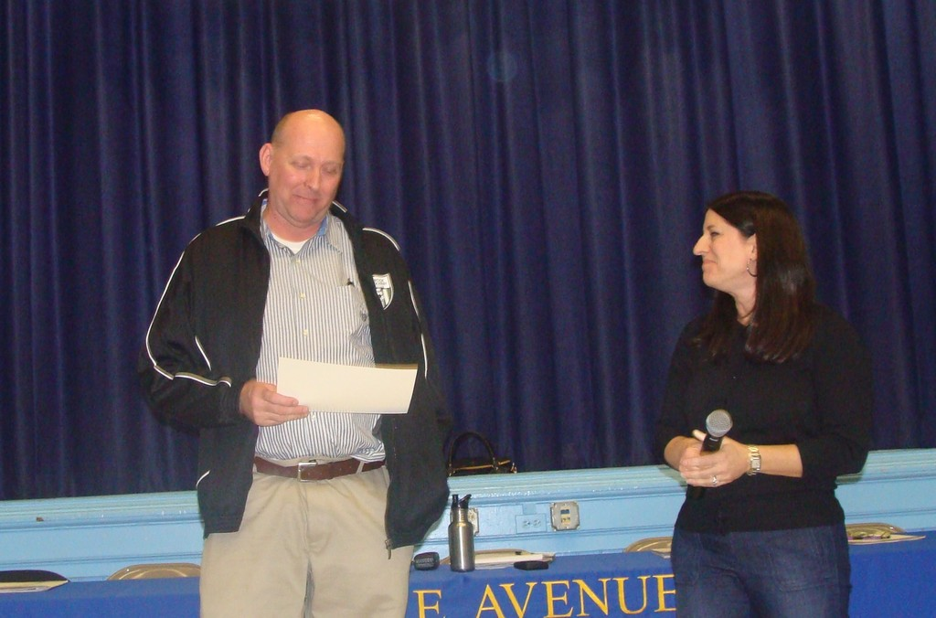 Don Poland was speechless (some say for the first time) after being presented with the contest's first Most Valuable Teacher award after dozens of students chose the popular teacher as someone who they would elect to be president. Lisa Burch presented Poland with the certificate.