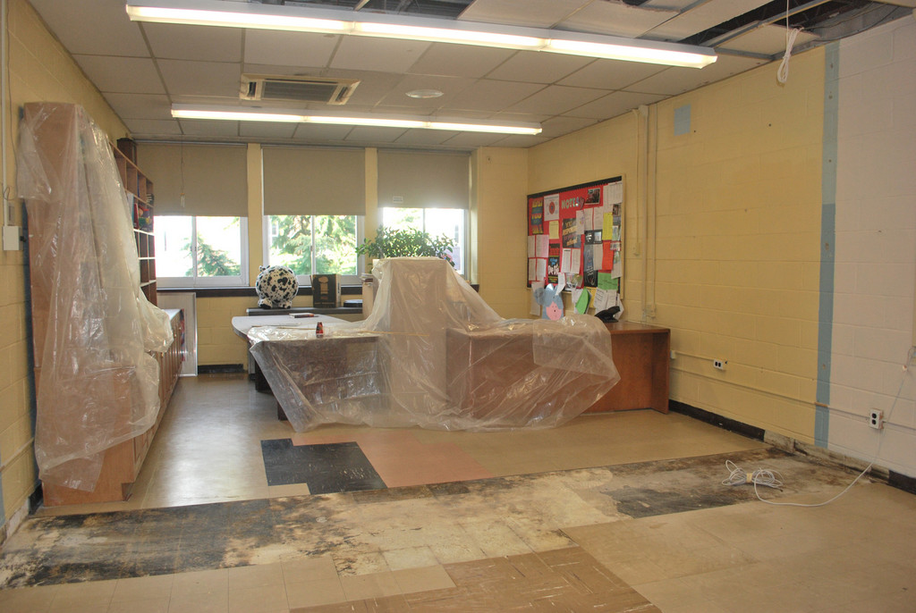 Office space is being converted into classrooms at the middle school to accommodate the increased student population due to the relocation plan.
