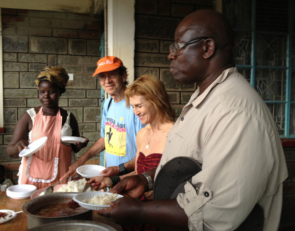 Richard Brodsky and wife Jill,, center, who travel to Africa annually to celebrate World AIDS Day on Dec. 1, served dinner to 300 children at Mama Pilista Bonyo Memorial Health Care Centre in Kenya in 2012.