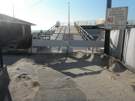 Putnam Boulevard has less foot traffic as Hurricane Sandy damaged the Atlantic Beach boardwalk forcing the village to close the approximately half-mile walkway until repairs are complete.