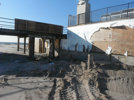 Hurricane Sandy tore up the beach and the underpinnings of the boardwalk. Storm winds ripped the Tyvek wrapping on a wall of the Sunny Atlantic Beach Club.