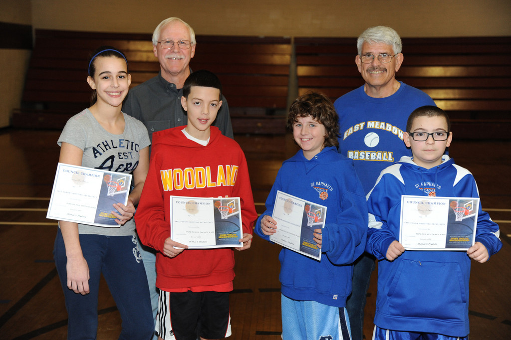Winners, bottom, from left, Samantha Fasano,13, Dan Amari, 13, Timothy Daly, 10, Anthony Sheck, 11, with Knights of Columbus members Paul Wissert and Alan Bacci.