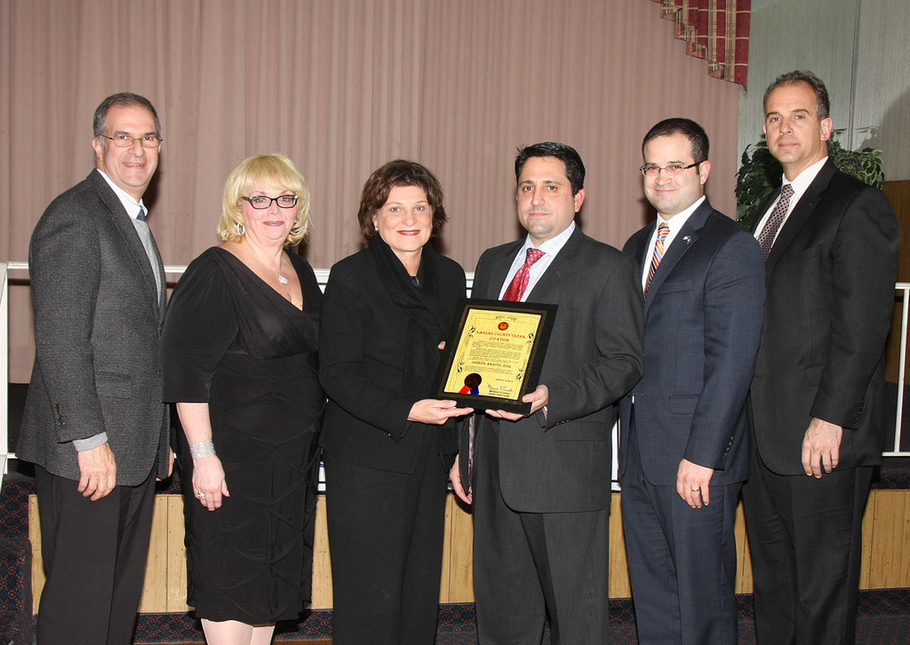 County Clerk Maureen O'Connell, center, presented a proclamation to 2013 Franklin Square Chamber President Joseph Ardito, Esq. at the Jan. 16 Installation Dinner. Looking on are Nassau County Legislator Vincent Muscarella, President of the Nassau Council of Chambers of Commerce Julie Marchesella, Assemblyman Edward Ra and Town of Hempstead Councilman Edward Ambrosino.