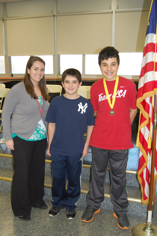 Social Studies teacher and Geographic Bee coordinator Keri Doyle, Tom Torquato and Vincent Gatto at the bee.