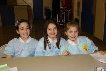 Little doctors Brianna Ruffino, Tess Drossman and Isabella DiClemente, all 10, helped at the blood drive.