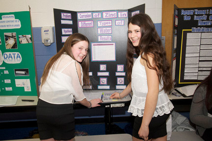 Rachel Esposito, 13, and Liana Weinstein, 13, present their project detailing the corrosion of Zinc.