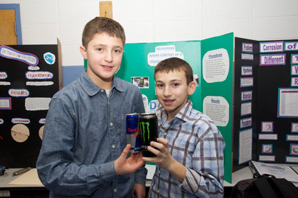 Brian Provvido, 13, and Matt DeGroot present their project detailing the sugar content of various energy drinks.