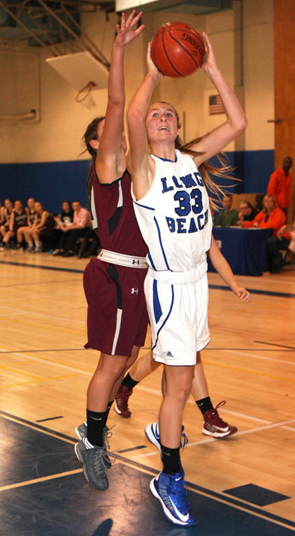 Long Beach's Aislinn Flynn goes up for two of her 12 points in last Friday's 41-36 upset of Conference AA-III rival Mepham.