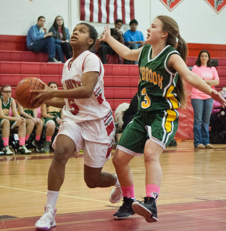 Junior Janise Hernandez, left, scored 21 points to lead Valley Stream South to its first win of the season, 42-33 over Lynbrook last Friday.