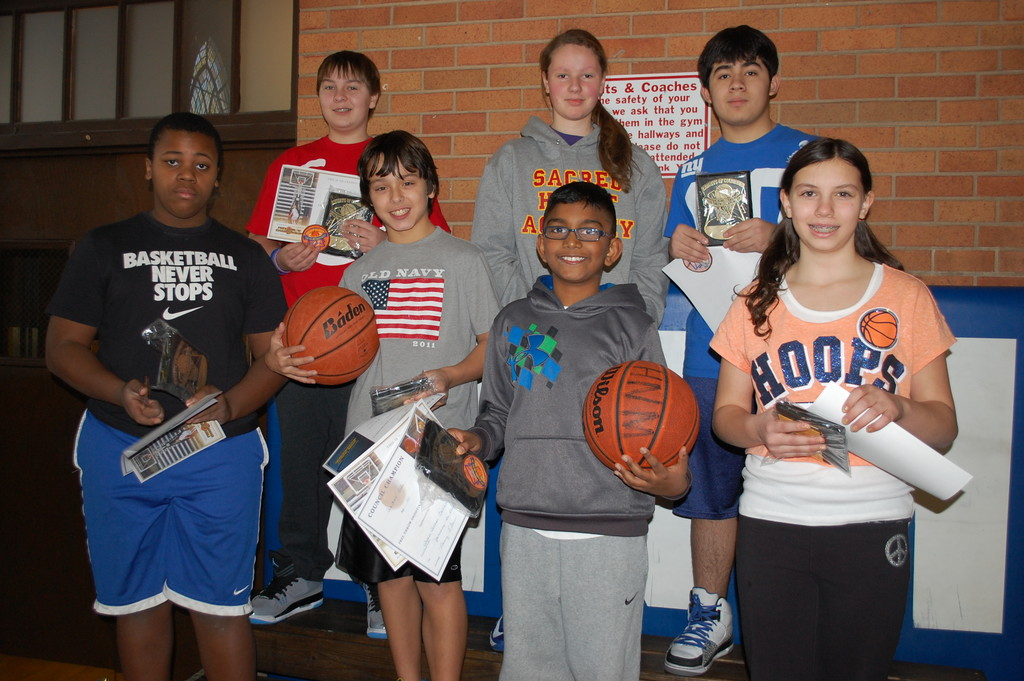 Winners of the contest, from left, were Malcolm Carter, Billy O'Brien, James Saracino, Aadam Alli, Rosemarie Falco, Sebastian Elizondo and Olivia Coletta.