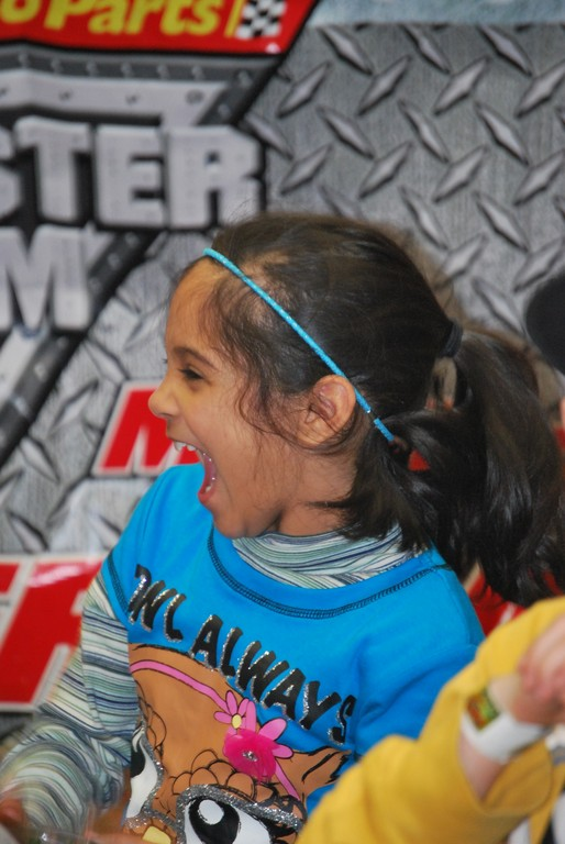 Number Five School third-grader Asmita Jaiswal showed her excitement after winning a toy monster truck through the raffle drawing.
