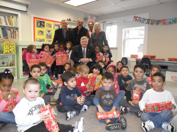 Peninsula Kiwanis lends a helping hand to several local organizations throughout the year and in emergencies such as Hurricane Sandy. At the Five Towns Early Learning Center in Inwood, Frank Mistero, Dominic Cura, Frank Basile and Kevin Cooney handed out Christmas gifts to the children, along with Center Executive Director Pepper Robinson.