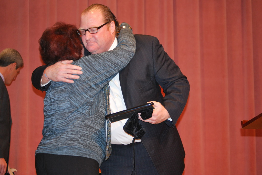 Woodmere resident Anne DeMichael hugged Five Towns Community Chest Chairman Eric Kesolwitz after she received the group's Citizenship Award.