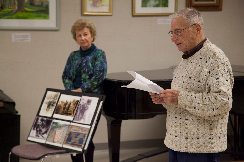 Bernard Rader, 89, with his wife, June, in the East Meadow Public Library as he retold his story of being a prisoner of war during World War II.