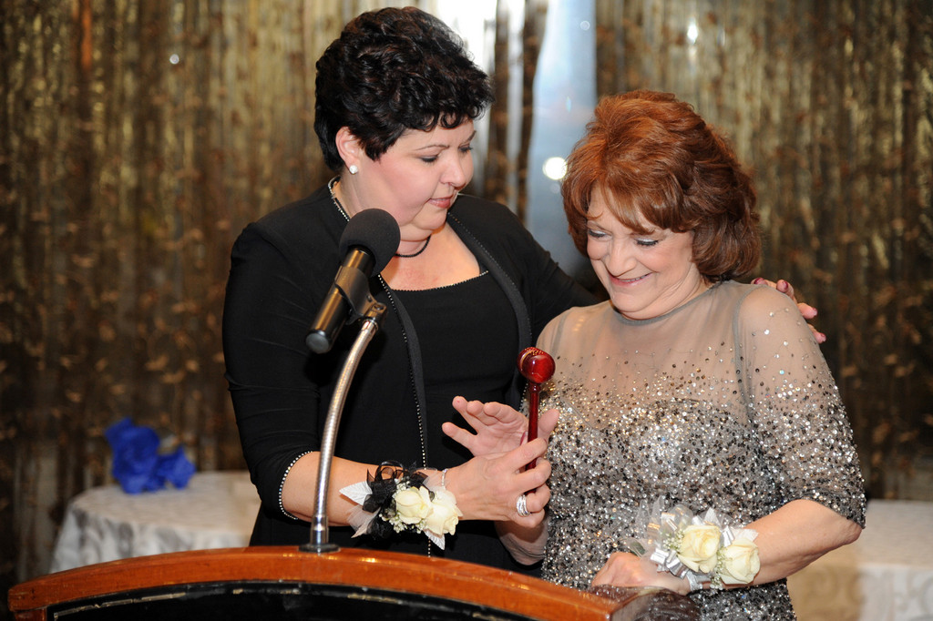 Outgoing East Meadow Chamber of Commerce President Millie Jones, left, passed the gavel to incoming President Dolores Rome during the chamber's 58th Annual Installation Dinner on Jan. 25 at the Cheateau Briand in Carle Place. Town of Hempstead Supervisor Kate Murray was honored as the Woman of the Year. Story, more photos, page 3.