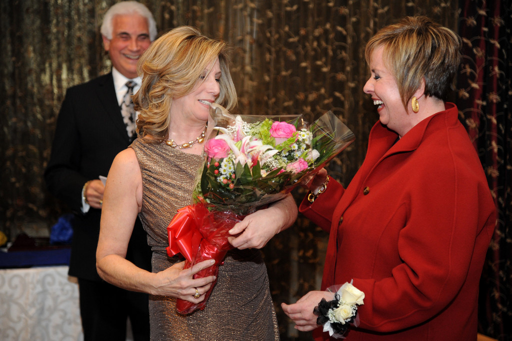 Eileen Wulff presented flowers to Town of Hempstead Supervisor Kate Murray, who was honored by the East Meadow Chamber of Commerce as the Woman of the Year during its 58th Annual Installation Dinner.