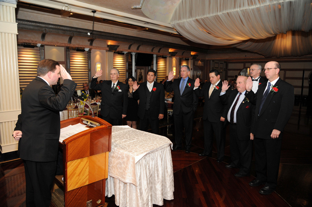 State Assemblyman Tom McKevitt swore in the incoming board of directors.
