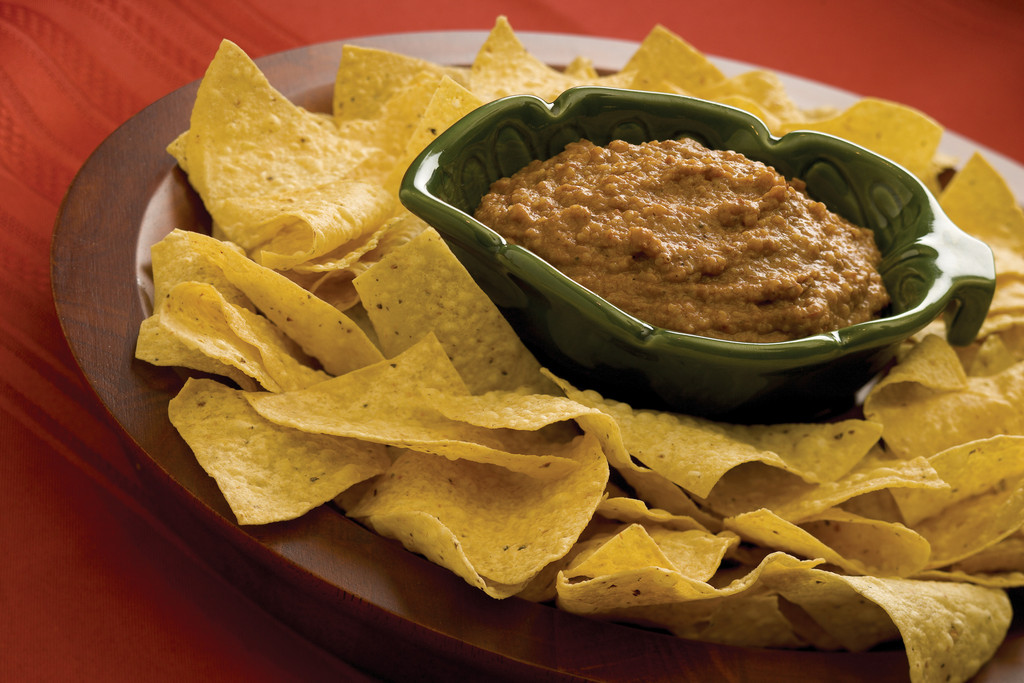 Tasty appetizers and dips, such as a red bean and rice dip, score big on game day with zesty flavors.