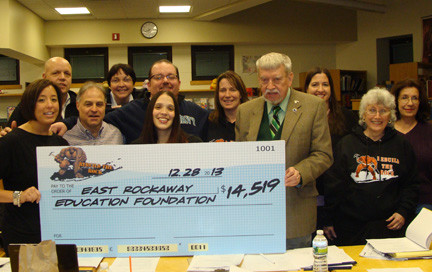 "east Rockaway Education Foundation board members accepted a check from alumni organizers of the event ""Rebuild the Rock,"" held last December. Pictured from left were event organizer Amanda Cooney, EREF board members Hugh Howard, Ken Pacheco, Vera Gallagher, Dan Caracciolo and Kristen Octera; EREF President Richard Meagher; and EREF board members Michelle Healy, Jane Brezenoff and Linda Howarth."