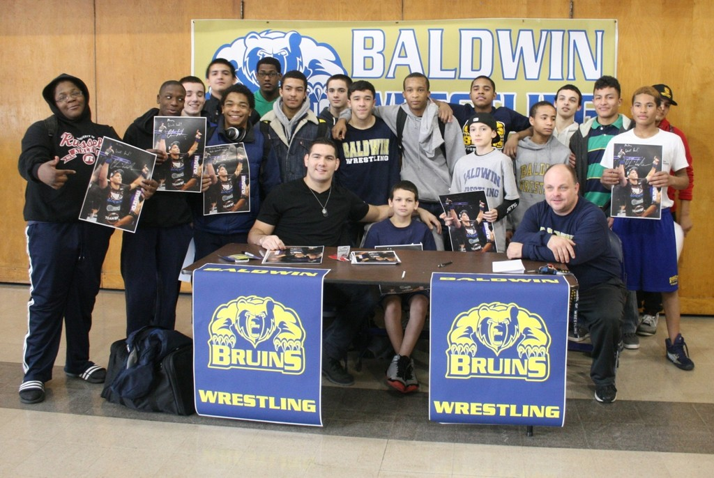 Chris Weidman, seated at left, a UFC star and 