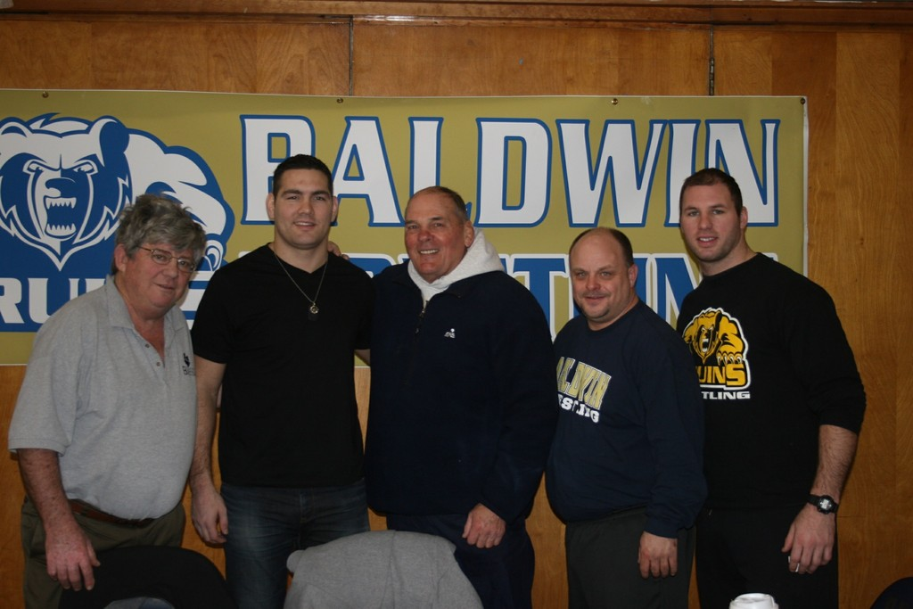 Weidman, second from left, reunited with Baldwin wrestling royalty recently. From left were B.A. Schoen, Steve Shippos, current coach Jim Murphy and assistant coach Tom Daddino.