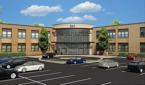 Main entrance and parking lot rendering of the medical practice targeted for the Number Six School.